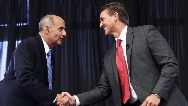 Democrat Richard Carmona, left, and GOP Rep. Jeff Flake are running for Arizona's open Senate seat.