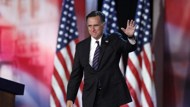 Mitt Romney waves to his supporters at his election night rally in Boston.