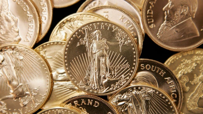 American Eagle and South African Krugerrand gold coins are pictured here.