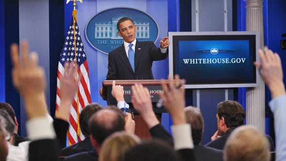 President Obama takes questions in the White House briefing room.