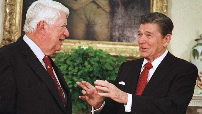 """President Ronald Reagan talks with House Speaker Thomas """"Tip""""  O'Neill at the White House in 1985."""