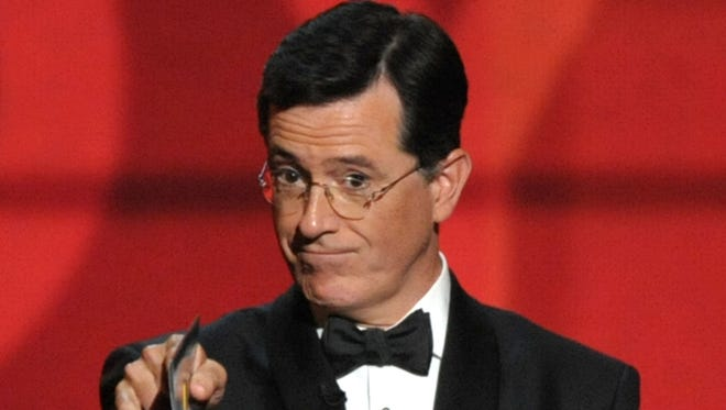 Stephen Colbert presents an award at the 64th Primetime Emmy Awards on Sept. 23.