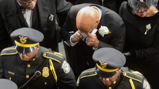 Rep. John Lewis, D-Ga., becomes emotional during the funeral of his wife, Lillian.