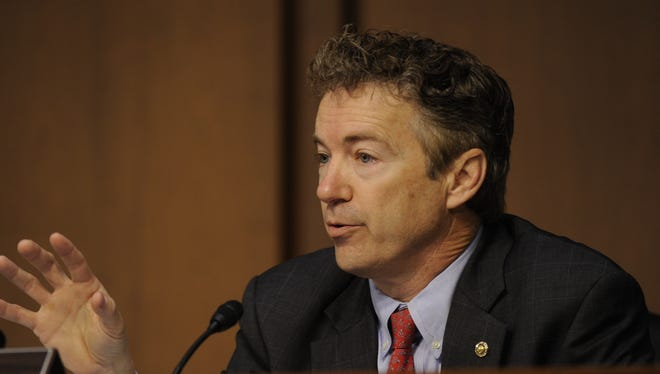Senator Rand Paul questions Secretary of State Hillary Clinton during hearing at which she answered questions about the September 11, 2012, terrorist attack on U.S. diplomatic facilities in Benghazi, Libya.
