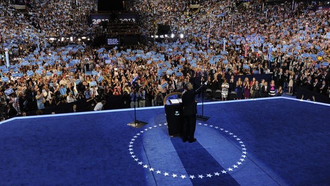 President Obama waves to the audience inside the Time Warner Cable Arena in Charlotte during his speech at the 2012 Democratic convention.