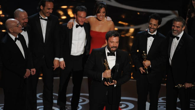 'Argo' director Ben Affleck accepts the Oscar for Best Picture at the Academy Awards.