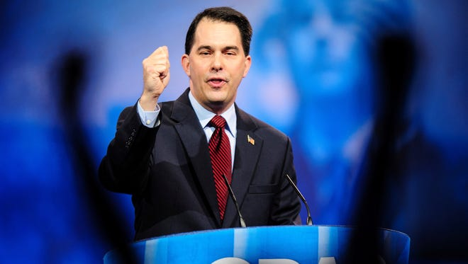 Gov. Scott Walker, R-Wis., was cheered at the Conservative Political Action Conference.