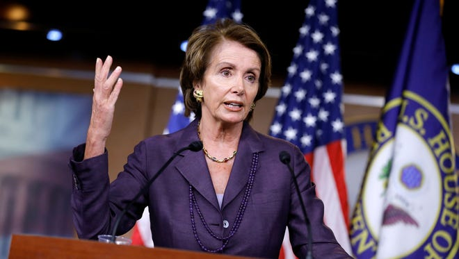 House Minority Leader Nancy Pelosi, D-Calif., talks to reporters on Capitol Hill.