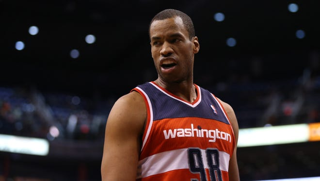 Jason Collins, a center for the Washington Wizards in 2012-13, declared he is gay in a magazine story.