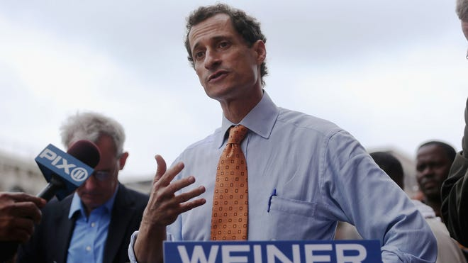 Anthony Weiner talks to reporters as he launches his campaign for New York City mayor.