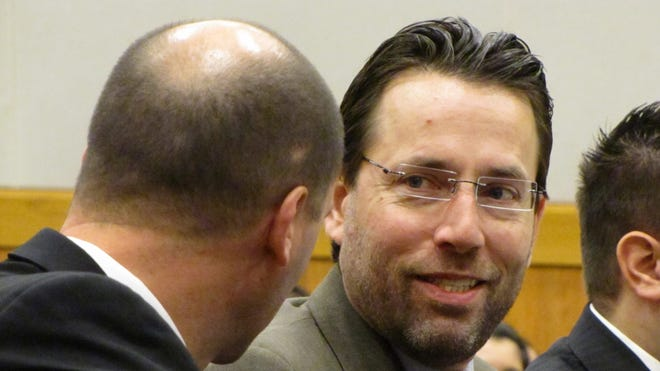 GOP Senate candidate Joe Miller, with glasses, conferred with his lawyer during a dispute over 2010 election results.