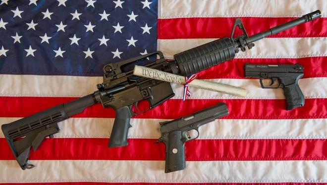 A photo illustration of rifles and handguns, including a Colt AR-15 semi-automatic rifle. Rep. Steve Stockman, R-Texas, is raffling a Bushmaster AR-15.