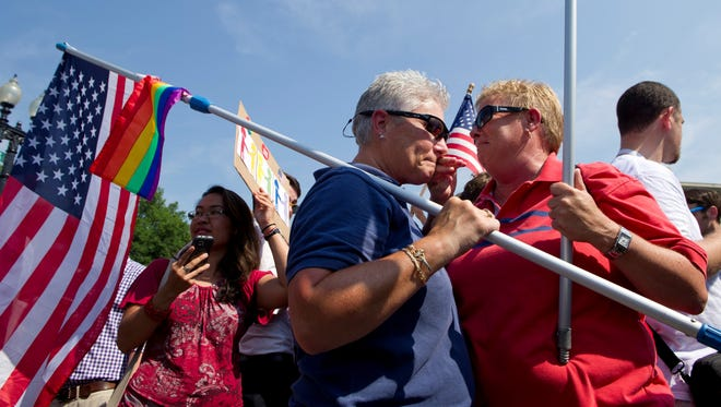 Partners Deb Gardiner, left, and Michele Horrigan of Maryland react to the Supreme Court's decision striking down the Defense of Marriage Act.