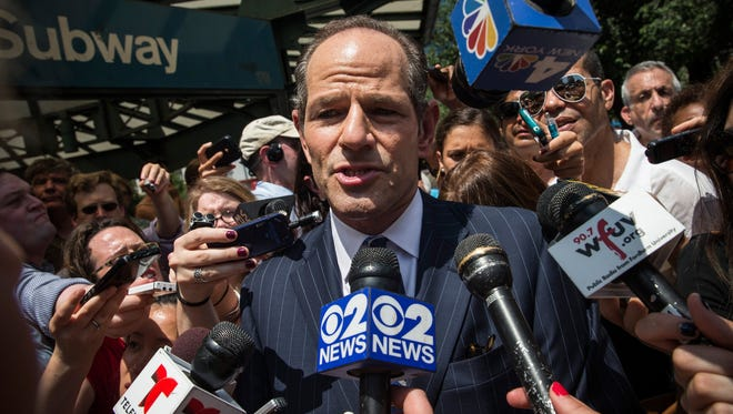 Former New York governor Eliot Spitzer talks to reporters about his political comeback bid.