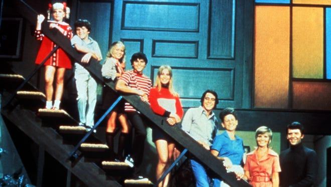 The Brady Bunch cast: Susan Olsen, Mike Lookinland, Eve Plumb, Christopher Knight, Maureen McCormick, Barry Williams, Ann B. Davis, Florence Henderson, Robert Reed.