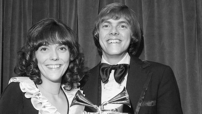 Karen and Richard Carpenter pose with their Grammys in 1972.