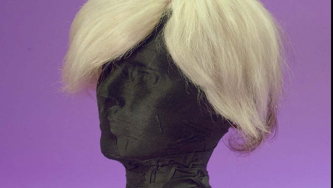 The @popcandy Twitter icon is a pic of Andy Warhol's wig.