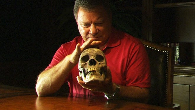 William Shatner strokes a skull on Syfy's 'Weird or What?'