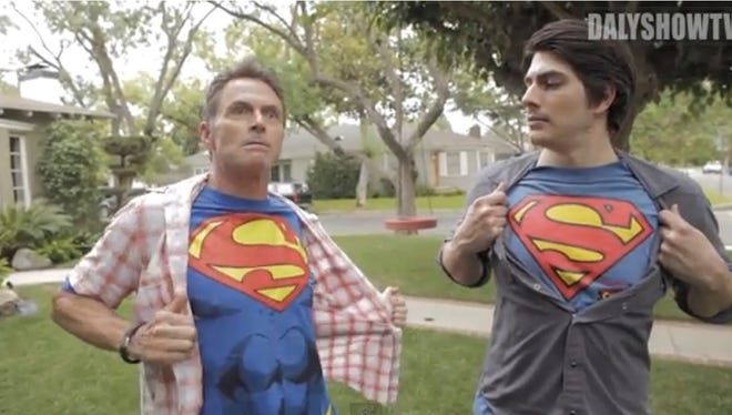 Tim Daly, left, and Brandon Routh show off their Superman chests.