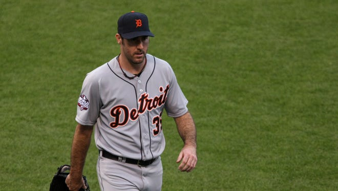 Justin Verlander walks off the field after the first inning of Game 1 of the World Series.