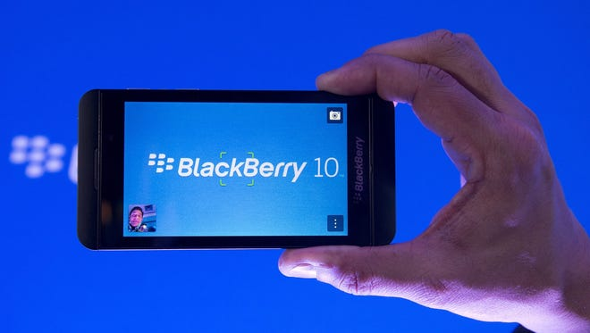 Arun Kumar, a senior product manager for BlackBerry, shows off the new BlackBerry Z10.