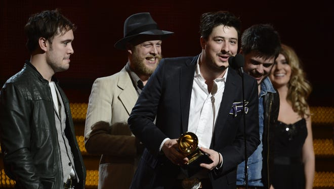 Mumford & Sons win album of the year at the 2013 Grammy Awards on Sunday in Los Angeles.