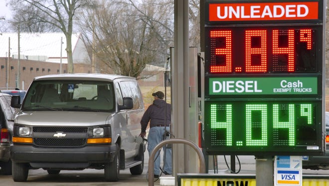 A customer buys gas at a McClure store in Marion, Ind., on Monday.
