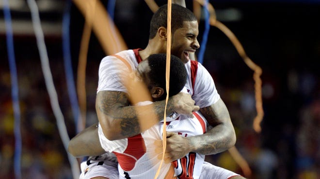 Louisville Cardinals forward Montrezl Harrell celebrates with forward Chane Behanan at the Georgia Dome on Monday.