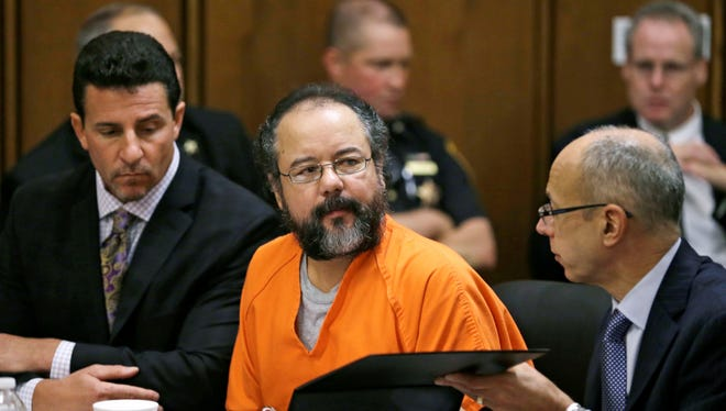Ariel Castro, center, listens  in the courtroom during the sentencing phase Thursday in Cleveland.