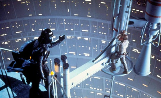 """Darth Vader (David Prowse, voiced by James Earl Jones) famously tells Luke Skywalker """"I am your father"""" in """"The Empire Strikes Back."""""""