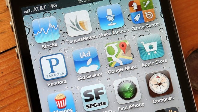A group of apps is shown on an Apple iPhone 4S.