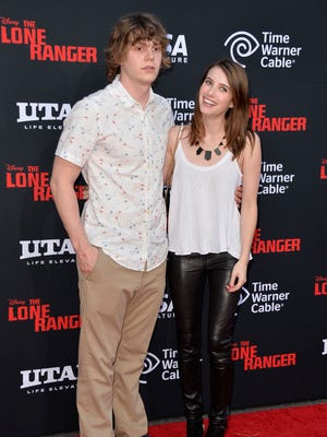 Emma Roberts and Evan Peters at 'The Lone Ranger' premier in June.