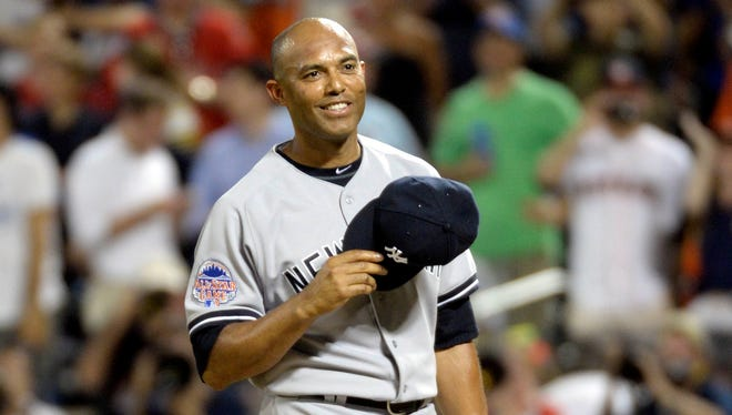 American League pitcher Mariano Rivera (42) of the New York Yankees waves to the crowd as he takes the mound in the 8th inning in the 2013 All Star Game at Citi Field.