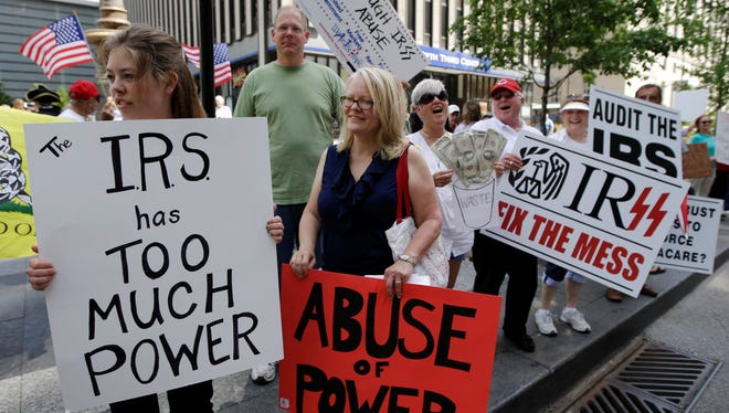 Tea Party activists demonstrate on Fountain Square before marching to the John Weld Peck Federal Building in Cincinnati May 21 to protest the Internal Revenue Service's targeting of conservative groups seeking tax-exempt status.
