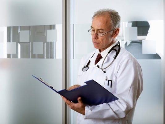doctor reading patient notes getty