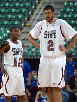 New Mexico State Aggies guard K.C. Ross-Miller (12) and center Sim Bhullar (2) during the championship game of the WAC tournament last season.