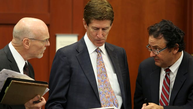 Co-defense attorney Don West, left, defense attorney Mark O'Mara, center, and jury consultant Robert Hirschhorn go over their juror list during the final stages of jury selection in the George Zimmerman trial in Seminole circuit court in Sanford, Fla., Thursday, June 20, 2013.