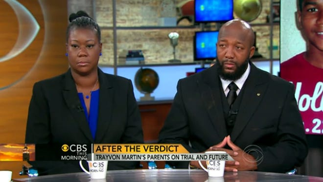 """This video screen grab from """"CBS This Morning"""" shows Sybrina Fulton and Tracy Martin, parents of slain Florida teen Trayvon Martin, during an interview Thursday."""