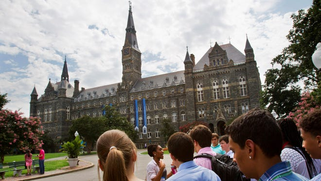 Prospective students tour Georgetown University's campus in Washington, D.C., on   July 10, 2013. Congress is attempting to reach a deal to head off a sudden rise in student loan interest rates.