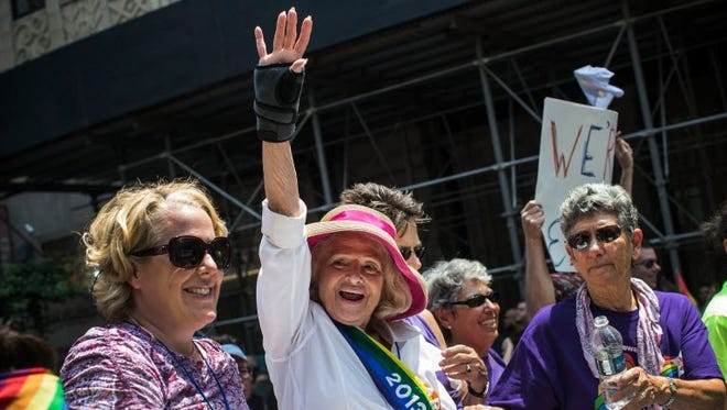 Edie Windsor, who successfully sued the U.S. government over the constitutionality of the Defense of Marriage Act, rides in a gay pride parade on June 30 in New York City.