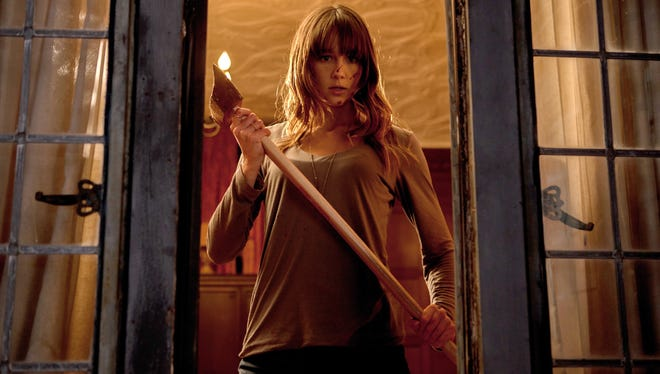 """When home invaders arrive, Erin (Sharni Vinson) picks an ax and gets to business in the horror movie """"You're Next."""""""