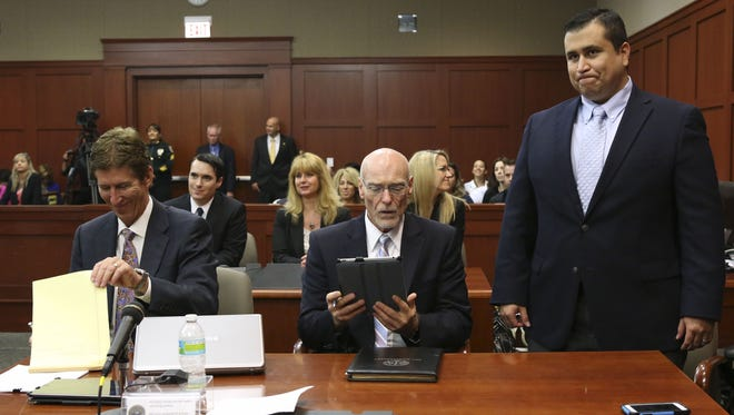 Defendant George Zimmerman, right, stands with his attorneys Mark O' Mara, left,  and Don West during his murder trial on July 12 in Sanford, Fla.