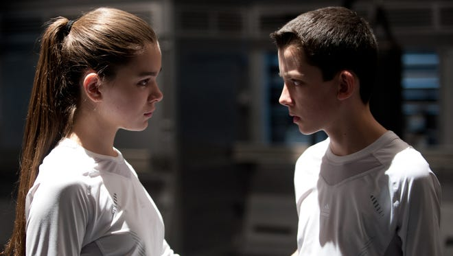 """Hailee Steinfeld and Asa Butterfield star as kids caught in an intergalactic war in """"Ender's Game."""""""