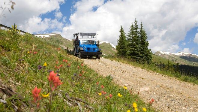 Summer guests can explore the snow-free terrain of Breckenridge, Colo., in a safari-style 4x4 vehicle.