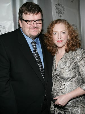 Michael Moore and wife Kathleen Glynn attend the National Board of Review Annual Gala on Jan.y 11, 2005 in New York City.
