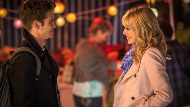 "Peter Parker (Andrew Garfield) flirts with Gwen Stacy (Emma Stone) in ""The Amazing Spider-Man 2."""
