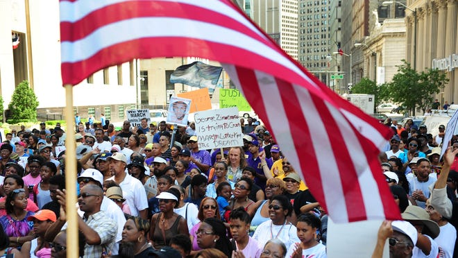 People gather in Detroit on July 20 to call for federal civil rights charges against George Zimmerman, who was acquitted a week earlier in the shooting death of Trayvon Martin in Florida.