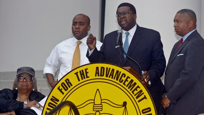 Florida House Democratic Leader Rep. Perry Thurston, Jr. speaks as Florida NAACP president Adora Obi Nweze, Rep. Alan Williams and Senate Democratic Leader Sen. Christopher Smith watch at a rally in response to George Zimmerman's acquittal.