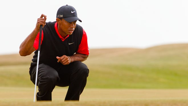 Tiger Woods on the fifth green during the final round of the 2013 Open Championship.