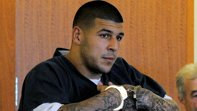 Former Patriots tight end Aaron Hernandez stands during a bail hearing in Fall River Superior Court in Fall River, Mass., on June 17.